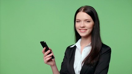Business woman dialing