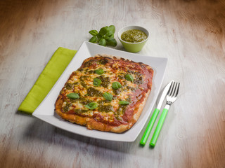 homemade pizza with pesto sauce