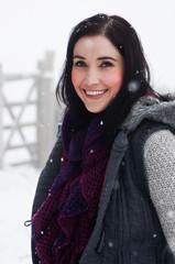 Woman wearing knitwear enjoying snow