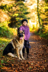 Young girl (2-3) with german shepherd in park