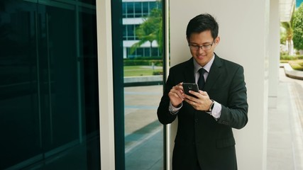 Businessman Writing With Pen On Mobile Phone Display