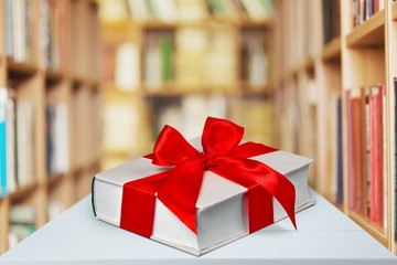 Book, gift, bow.