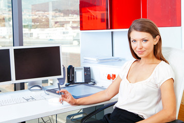 Businesswoman at desk in the office