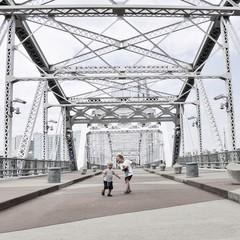 Boys dancing on bridge