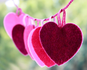 Hearts hanging on string