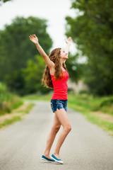 Happy teenager walking on the road