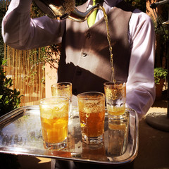 Morocco, Marrakesh, Waiter pouring tea during tea ceremony