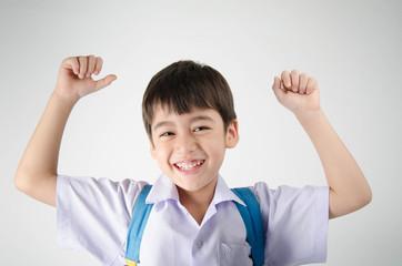 Little student boy in uniform on white background