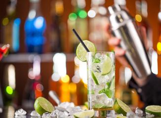 fresh mojito drink on bar desk