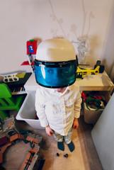 Netherlands, Boy (4-5) wearing policeman's helmet with visor