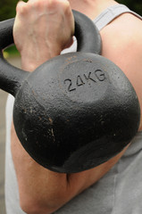 man holding kettlebell to push out