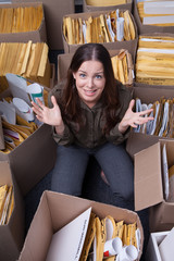 Businesswoman surrounded by boxes of paperwork