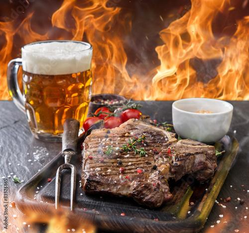 Fototapeta Beef steak on wooden table