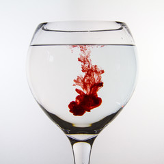 Red ink dropped into water