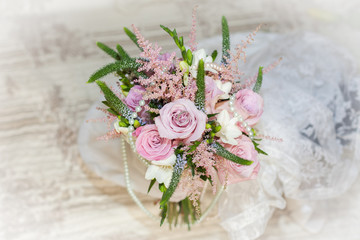 Bunch of wedding flowers on table