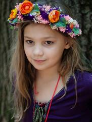 Girl wearing garland of flowers on head