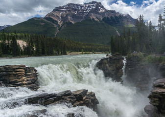 Canada, Alberta, Jasper National Park, View of Athabasca Falls and Mt Kerkeslin in background
