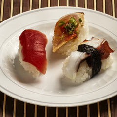 Nigiri Sushi assortment on white plate