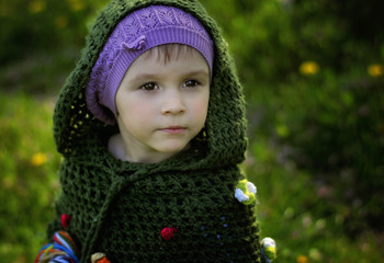 Young girl wearing green hooded top