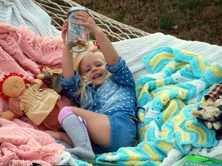 Happy girl resting in hammock