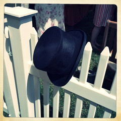 UK, Berkshire, Ascot, Top Hat hanging from fence