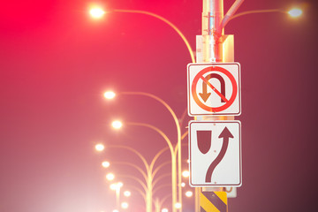 Road Signs And Illuminated Street Lights