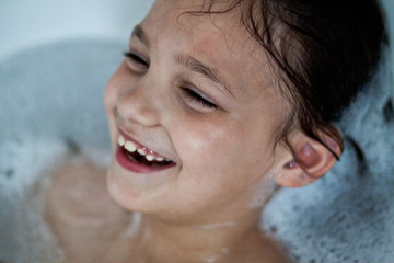 Girl (6-7) taking bath