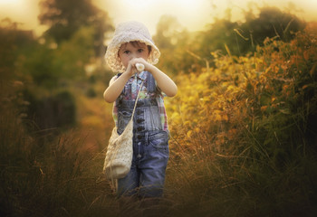 Girl outdoors playing recorder