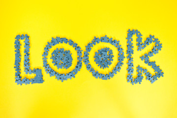 The word look spelled out in jigsaw pieces