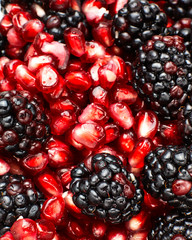 Close-up shot of mixture of blackberries and pomegranate seeds