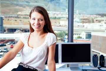 Young smiling businesswoman in the office
