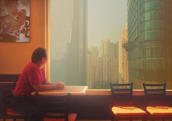 China, Shanghai, Man sitting at table
