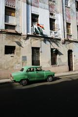 Cuba, Havana, Old car parked on street