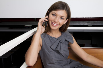 Young woman using phone in the office
