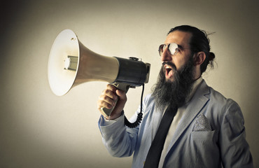 Man screaming into a megaphone