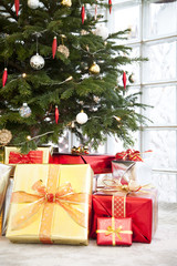 Close up of gifts under a Christmas tree
