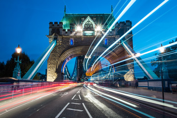 United Kingdom, England, London, Light streams from traffic crossing Tower Bridge