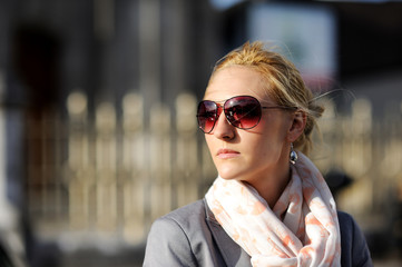 Woman with sunglasses on street in sunny day