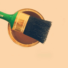 Close up of paintbrush on top of paint can