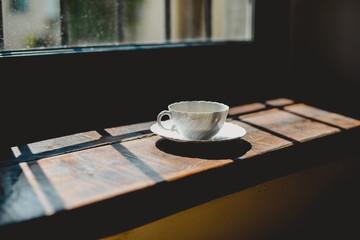 Italia, Lombardia, Pavia, Cup of coffee beside window