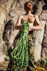 USA, Colorado, Mesa County, Grand Junction, Rock climber coiling rope in Unaweep Canyon