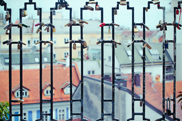 Croatia, Zagreb, View of cityscape from behind bars of fence