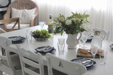 Dining table set for lunch with crockery