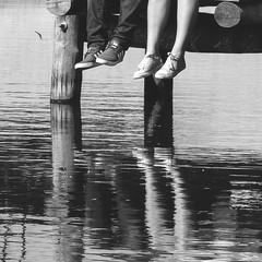 Reflection in water of two pairs of legs