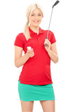 Blond female golfer holding a golf club