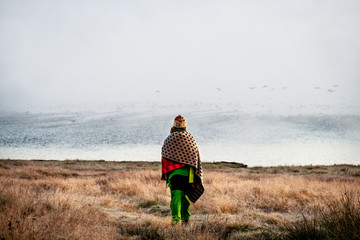 Bulgaria, Batak, Woman walking towards lake