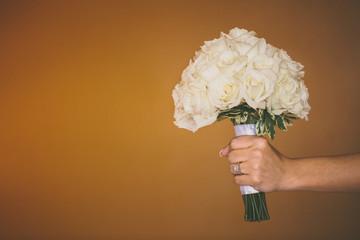 USA, Florida, Okaloosa County, Fort Walton Beach, Bride holding bouquet of roses