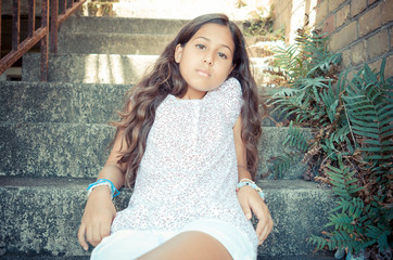 Young Girl Sitting On Some Steps