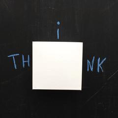 View of blank adhesive note on blackboard