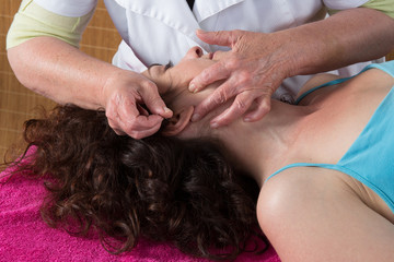 Close-up Of A Woman Getting Acupuncture Treatment